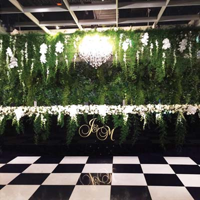 green wall wedding chandelier