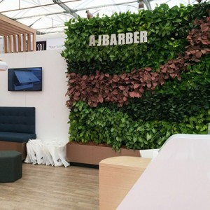 casual-aj-barber-dentist-exhibition-green-wall-gsky-versa-wall-3 cropped-400x400