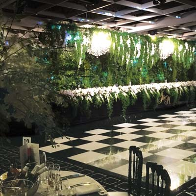 green wall wedding chandelier