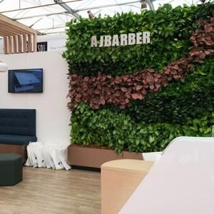 casual-aj-barber-dentist-exhibition-green-wall-gsky-versa-wall-3 cropped-400x400